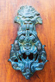 Antique doorknocker in the Provence, France Royalty Free Stock Photography