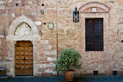 Antique doorway to the Tuscan house Stock Photography