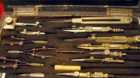 Antique Draftsman Set. With pairs of compasses and other drafting tools Stock Images