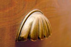 Antique Drawer Pull. Close-up of a old drawer pull clamshell Royalty Free Stock Photos