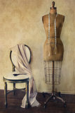 Antique dress form and chair with vintage feeling Stock Image