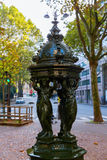Antique drinking fountain in Paris Royalty Free Stock Photo