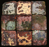 Antique Dutch Farmhouse floor tiles. Dating end of 18th Century. Found in a farmhouse in the North of the Netherlands, province Friesland. Terracotta with warn Stock Photography