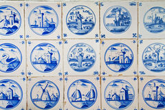 Antique dutch tiles. On the kitchen wall of an old building Stock Photos