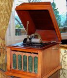 Antique Edison Gramophone Record Player. Antique Edison gramophone with crank handle from the 1920`s. A piece of luxury entertainment found in the homes of the Stock Photo