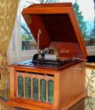 Antique Edison Gramophone Record Player. Antique Edison gramophone with crank handle from the 1920`s. A piece of luxury entertainment found in the homes of the Stock Image