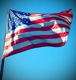 Antique effect for the large American flag waving Stock Photo