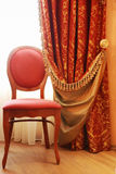 Antique elegance chair. And curtain with tassels stock photography