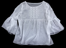 Antique embroidered women's blouses. On a black background stock photography