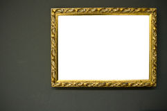 Antique empty golden frame on grunge wall Stock Images