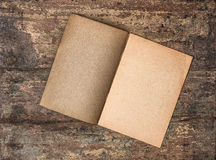 Antique empty journal on grungy wooden background. Paper texture Stock Image