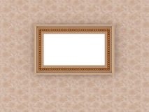 Antique empty picture frame on vintage wallpaper Stock Photography