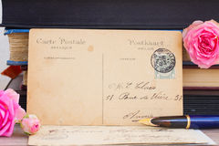 Antique empty postcard with flowers and quill pen Royalty Free Stock Photo