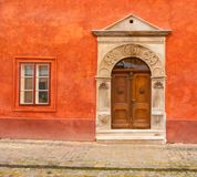 Antique entrance in a red wall Royalty Free Stock Photos