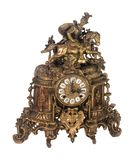 Antique equestrian brass mantle clock on white royalty free stock image