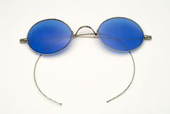 Antique Eyeglasses with Blue Lenses and Wire Frame Royalty Free Stock Photography