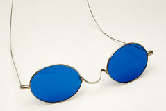 Antique Eyeglasses with Blue Lenses and Wire Frame Stock Photo