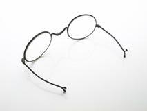 Antique eyeglasses on white table Stock Photo