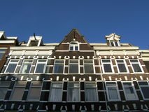 Antique facade in Amsterdam. Beautiful ancient home facade in Amsterdam : Netherlands, Europe royalty free stock images
