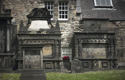 Antique facades and cemetery in Edinburgh city downtown. Scotlan Stock Images