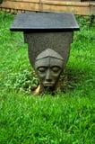 Antique face stone bench Royalty Free Stock Photos