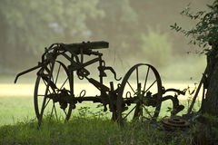 Antique Farm Equipment in fog Stock Images