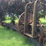 Antique farm machine in field Stock Images