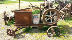 Antique farm machinery. Yard filled with antique farming machinery on sunny day Stock Photography