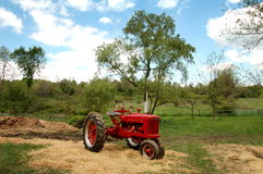 Antique Farm Tractor. Antique tractor sitting in country landscape Stock Photo
