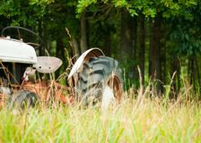 Antique farm tractor in field stock photography