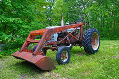 Antique Farmall trackor. Colorful photo of a antique tractor with trees in Minnesota stock photos