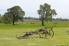 Antique farming equipment. In middle of field Stock Images