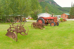 antique farming equipment on display in northern bc Stock Photo
