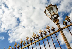 Antique fence and streetlamp Royalty Free Stock Image
