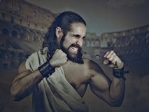 Antique fighter, gladiator. retro styled male portrait. With abstract medieval backgrounds Royalty Free Stock Photo