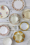 Antique Figure Plates Assorted Vintage China Pattern White Background. Set of plates with antique figure border pattern assorted vintage china on white painted royalty free stock image
