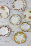Antique Figure Plates Assorted Vintage China Pattern White Background. Set of plates with antique figure border pattern assorted vintage china on white painted royalty free stock photos