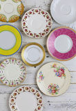 Antique Figure Plates Assorted Vintage China Pattern White Background. Set of plates with antique figure border pattern assorted vintage china on white painted stock images