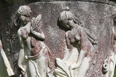 Antique figures of girls. Repousse of two girls during harvest time Stock Image