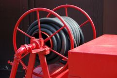 Antique fire engine hose Stock Photography