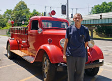 Antique Fire Engine with Owner. Antique 1937 Dodge red fire engine with proud owner royalty free stock image