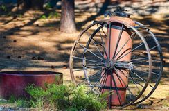 Antique Fire Extinguisher and Wagon Wheels. On display in high desert logging museum, Collier Memorial State Park Logging Museum Stock Photography