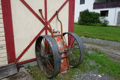 An antique fire extinguisher with wheels. Royalty Free Stock Image