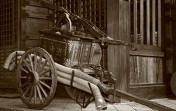 Antique fire pump. Royalty Free Stock Photo