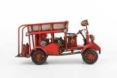 Antique Fire truck model on white background. Antique Toy Fire Engine on white background, isolated royalty free stock photo