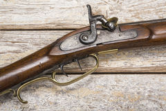 Antique firearm weathered background Royalty Free Stock Images