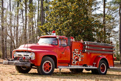 Antique Firetruck. An old vintage antique firetruck ready for action Stock Photo