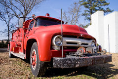 Antique Firetruck. An old vintage antique firetruck ready for action Royalty Free Stock Photos
