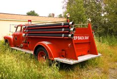 Antique Firetruck - 4. Old fire truck parked behind the community fire station in a rural town in Maine royalty free stock photo