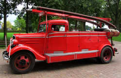 Antique Firetruck of red color Netherlands Royalty Free Stock Photos